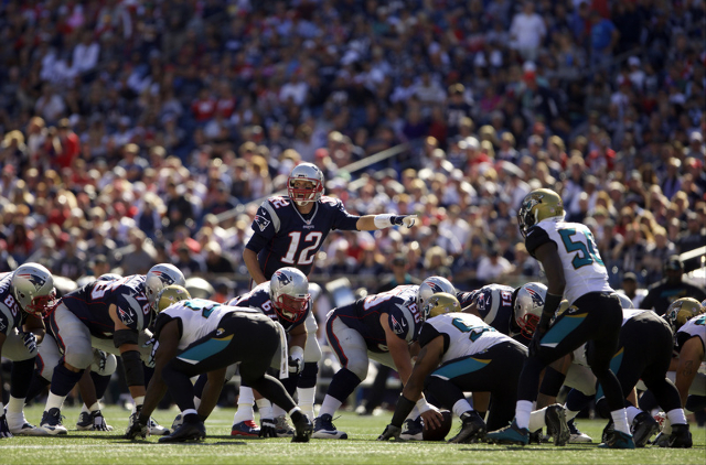 Sep 27, 2015; Foxborough, MA, USA; New England Patriots quarterback Tom Brady (12) at the line of scrimmage as they take not the Jacksonville Jaguars in the second half at Gillette Stadium. The Pa ...
