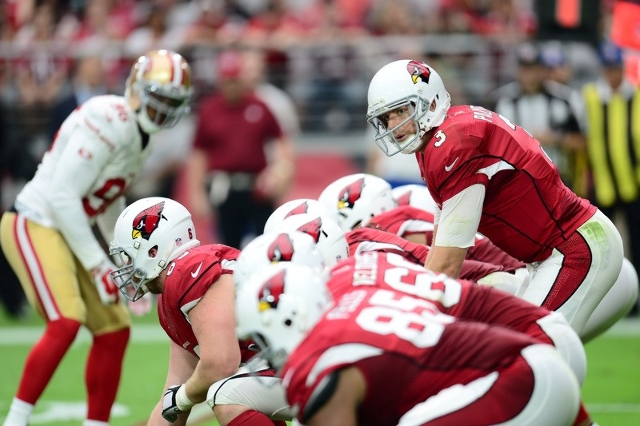 Arizona Cardinals quarterback Carson Palmer calls plays against the San Francisco 49ers during the first half at University of Phoenix Stadium. The Cardinals won 47-7. (Joe Camporeale-USA TODAY Sp ...