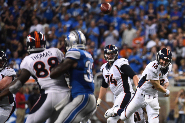 Denver Broncos quarterback Peyton Manning (18) throws the ball to Demaryius Thomas (88) during the fourth quarter against the Detroit Lions at Ford Field. (Tim Fuller-USA TODAY Sports)
