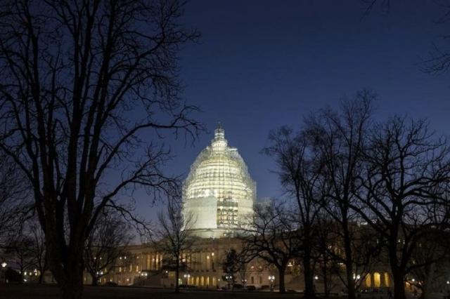 The U.S. Capitol is lit in Washington February 11, 2015. (Reuters/Joshua Roberts)