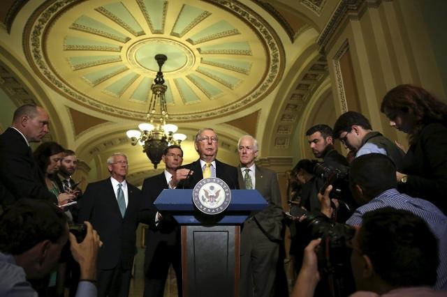 (L-R) Senate Republican leaders (at podium), Senator Roger Wicker (R-MS), John Barrasso (R-WY), Senate Majority Leader Mitch McConnell (R-KY) and Senate Majority Whip John Cornyn (R-TX) take quest ...