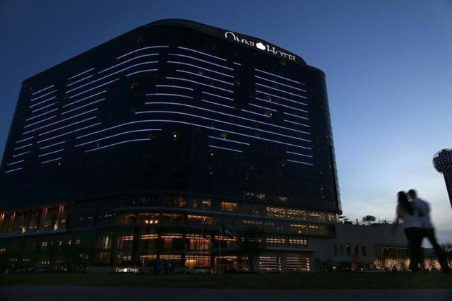 The NCAA logo is seen on the side of a hotel in Dallas, Texas, March 30, 2013. (Jim Young/Reuters)