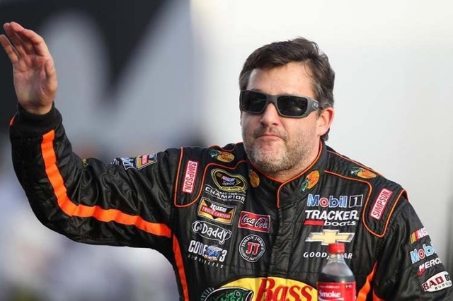 Aug 31, 2014; Hampton, GA, USA; NASCAR Sprint Cup Series driver Tony Stewart (14) prior to the race at Atlanta Motor Speedway. (Marvin Gentry/USA Today Sports)