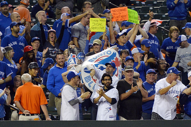 Sep 30, 2015; Baltimore, MD, USA; Toronto Blue Jays fans cheer after first baseman Justin Smoak (not pictured) two run home run during the ninth inning against the Baltimore Orioles  at Oriole Par ...