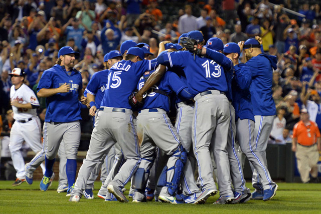 Sep 30, 2015; Baltimore, MD, USA; Toronto Blue Jays celebrate on the field after clinching the A.L East division at Oriole Park at Camden Yards. Toronto Blue Jays defeated Baltimore Orioles 15-2.  ...