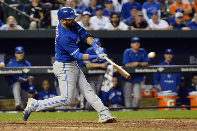 Sep 30, 2015; Baltimore, MD, USA; Toronto Blue Jays right fielder Jose Bautista (19) hits a solo home run in the ninth inning against the Baltimore Orioles at Oriole Park at Camden Yards. Toronto  ...