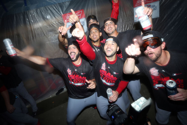 Sep 30, 2015; Pittsburgh, PA, USA; St. Louis Cardinals players pose for a photo after defeating the Pittsburgh Pirates to clinch the National League Central Division Championship at PNC Park. The  ...