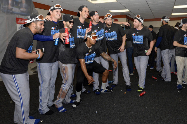 Sep 30, 2015; Baltimore, MD, USA;  Toronto Blue Jays celebrate winning the A.L. East division after game two of a double header in the visiting locker room at Oriole Park at Camden Yards. The Toro ...