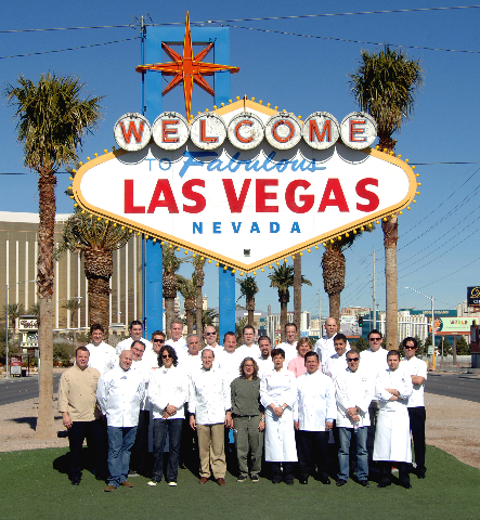 "Las Vegas Chefs pose at the ""Welcome to Fabulous Las Vegas"" sign on Feb. 13, 2008. Kerry Simon is in the front row, third from left. CREDIT: Darrin Bush/Las Vegas News Bureau"