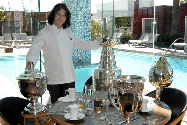 Kerry Simon, Executive Chef/Restaurant Partner, poses with the NHL Trophies at Simon Restaurant in Palms Place, Las Vegas on April 7, 2009. CREDIT: Glenn Pinkerton/Las Vegas News Bureau