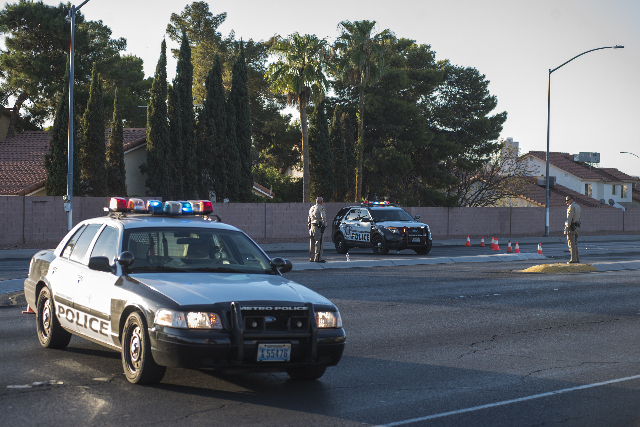 Metro Police officers direct traffic between the intersection of Rainbow and Alta after an officer involved shooting in Las Vegas on Friday, Sep. 4, 2015. (Martin S. Fuentes/Las Vegas Review-Journal)