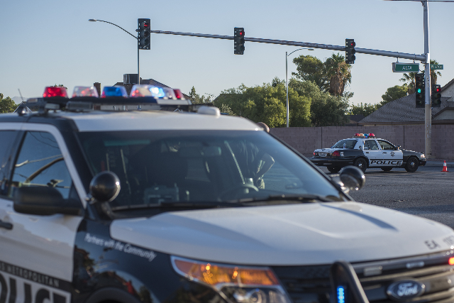 Metro Police officers gather between the intersection of Rainbow and Alta after an officer involved shooting in Las Vegas on Friday, Sep. 4, 2015. (Martin S. Fuentes/Las Vegas Review-Journal)