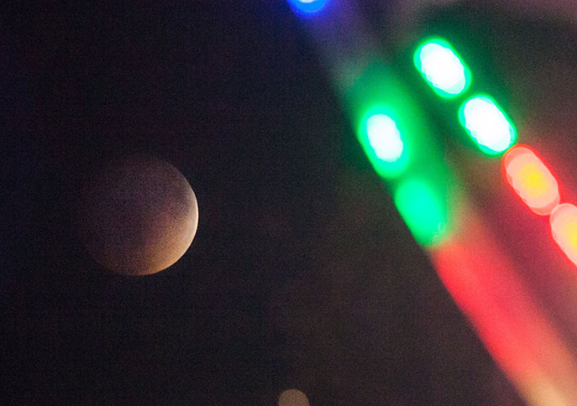 "The ""blood moon"" rises, as seen through a ferris wheel during the Life is Beautiful festival, in downtown Las Vegas on Sunday, Sept. 27, 2015. Chase Stevens/Las Vegas Review-Journal Foll ..."