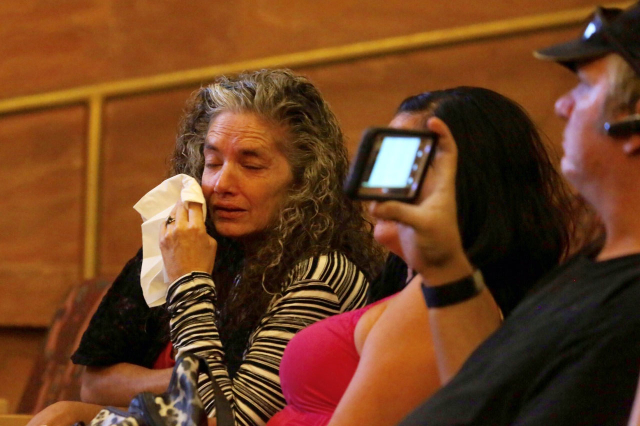 Debbie Wilcox, mother of Joseph Wilcox, wipes a tear during the Public Fact Finding review for the June 8 2014 ambush of officers Alyn Beck and Igor Soldo by two anti-government zealots, Jerad and ...