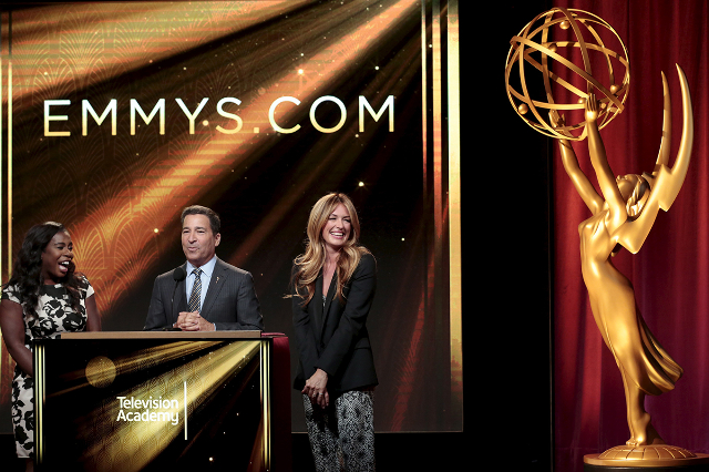 Actresses and nominees Uzo Aduba (L) and Cat Deeley (R) with Television Academy chairman and CEO Bruce Rosenbaum (center) are pictured during the nomination announcements for the 67th Primetime Em ...