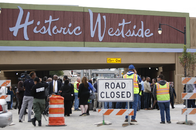 People gather for the reopening ceremony of F Street in Las Vegas near McWilliams Avenue and beneath Interstate 15 in Las Vegas Thursday, Dec. 11, 2014. (Erik Verduzco/Las Vegas Review-Journal)