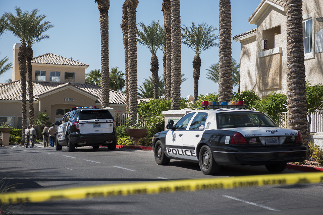 Metro investigates at the La Villa Estates apartments after a fire was reported in an apartment on Monday, April 20, 2015. One person was reported deceased. (Martin S. Fuentes/Las Vegas Review-Jou ...
