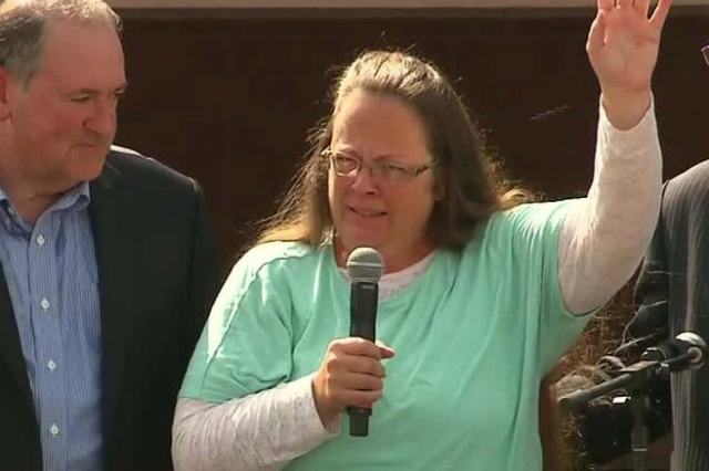 Rowan County Clerk Kim Davis, flanked by Republic presidential candidate Mike Huckabee, left, attorney Mathew Staver and her husband, Joe Davis, celebrates her release from the Carter County Deten ...