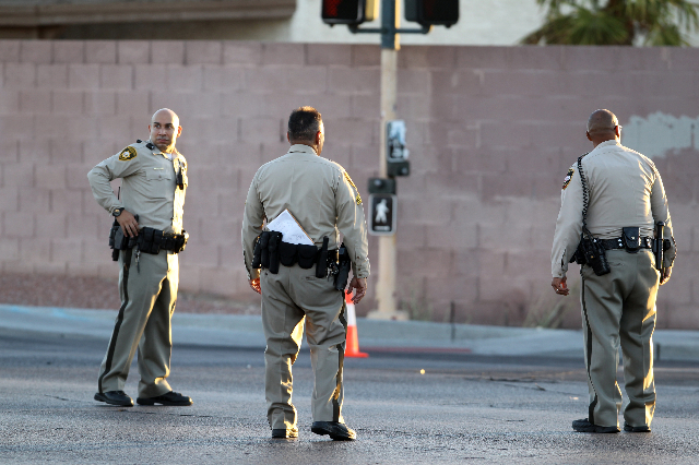 Las Vegas police search Rainbow Boulevard between U.S. Hwy. 95 and Alta Drive where a Metro officer was shot early Friday morning Sept. 4, 2015. The officer, who was shot in the leg, is in surgery ...