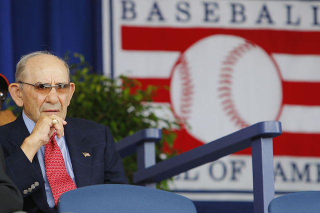 Hall of Famer Yogi Berra takes his seat for the 2009 National Baseball Hall of Fame Induction ceremonies in Cooperstown, New York July 26, 2009.   REUTERS/Brian Snyder    (UNITED STATES SPORT BASE ...
