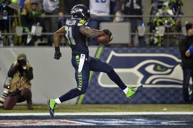January 10, 2015; Seattle, WA, USA; Seattle Seahawks strong safety Kam Chancellor (31) runs the ball in for a touchdown after intercepting a pass against the Carolina Panthers during the second ha ...