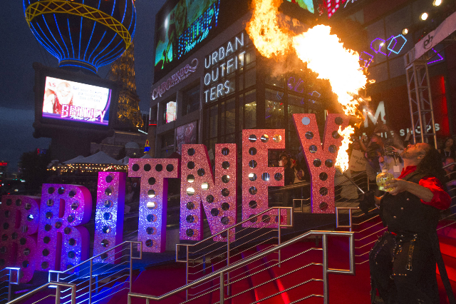 A fire eater performs during an arrival ceremony for singer Britney Spears at Planet Hollywood Resort and Casino in Las Vegas, Nevada December 3, 2013. Spears is making preparations for the debut  ...