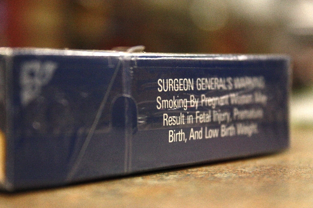 A close-up photograph showing the Surgeon General's Warning on a pack of cigarettes. (Sarmad Qaseera/CNN)