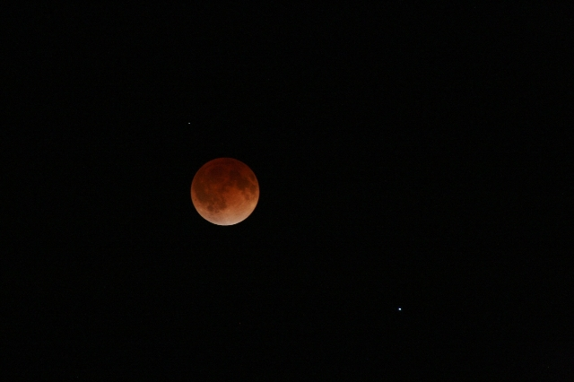 """CNN iReporter Dan Huntley mostly does landscape and travel photography, but he turned his camera to the sky for this shot of the """"blood moon"""" over Dallas. Huntley has seen eclipses befor ..."""