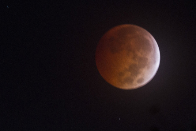 """People throughout the United States had a front-row seat for """"Blood Moon,"""" a lunar eclipse that made the moon look a burnt reddish-orange. This eclipse, on October 8, 2014, was the secon ..."""