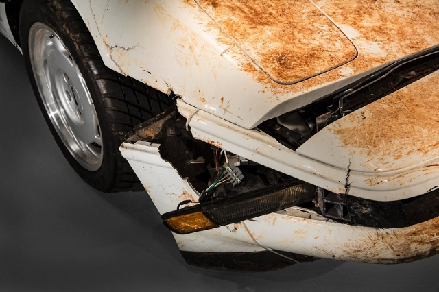 Of the three repairable Corvettes that fell down a sinkhole at Kentucky's National Corvette Museum  February, 2014 the 1 millionth Corvette -- a white, 1992 convertible -- will be the hardes ...