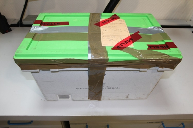 A photograph of the cockpit voice recorder (located inside the box) brought to the BEA on the morning of the March 25, 2015. (BEA/CNN)