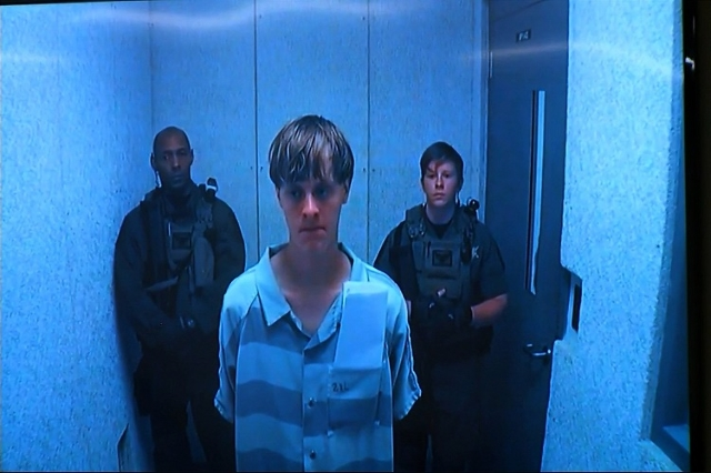 Accused Charleston church shooter Dylann Roof looked solemn as he appeared remotely by video before a judge on June 19, 2015. (Pool/CNN)