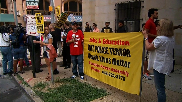 Protesters rally near the courthouse in Baltimore, Maryland on Wednesday, September 2, 2015, as six Baltimore police officers charged in Freddie Gray's death are due in court.