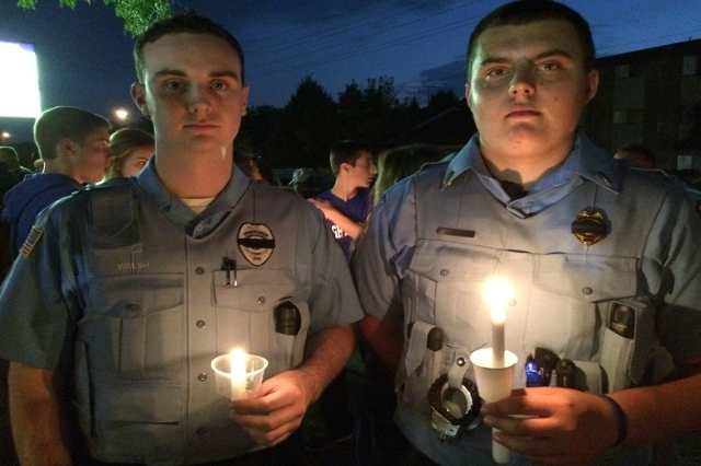 Residents and fellow police officers gather at the Fox Lake, Illinois Police Department on September 2, 2015, to remember the life of Lt. Joe Gliniewicz. Gliniewicz was shot and killed on Tuesday  ...