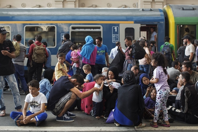 Immigrants stand on the platform of the Keleti train station in Budapest waiting for a train on September 3, 2015. (CNN/Roberto Salomone)