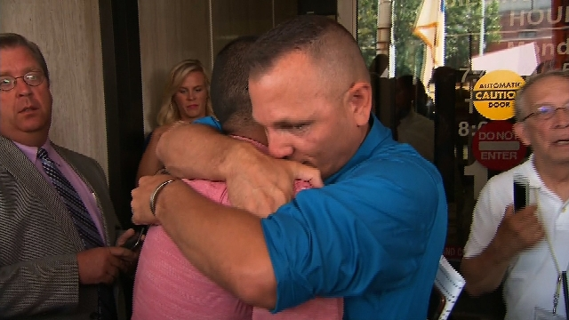Jonathan and Dwayne Beebe-Franqui of Pensacola, Florida, embrace following a judge ordering Rowan County, Kentucky, Clerk Kim Davis into custody after she failed to issue same-sex marriage license ...