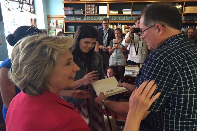 Hillary Clinton met with Tom Holbrook, owner of the bookstore and Flannery Holbrook, his daughter as part of a campaign stop in Portsmouth, New Hampshire Saturday, September 5, 2015. Clinton said  ...