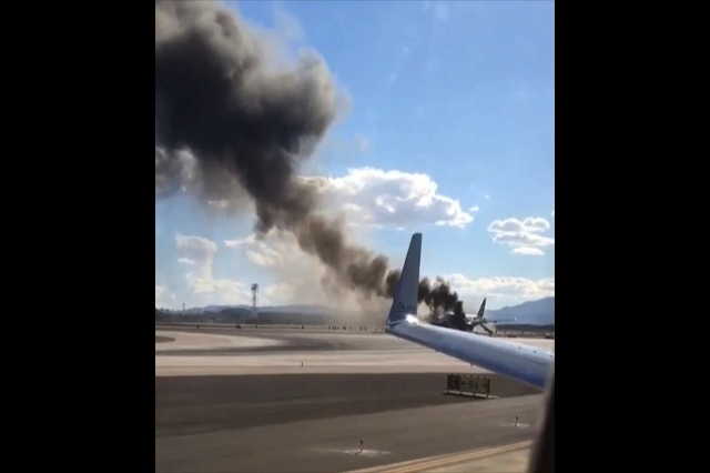 "A fire broke out Tuesday on an outbound British Airways flight at Las Vegas' airport, leading two people to be transported for medical care for what the airport called ""minor injuries.& ..."