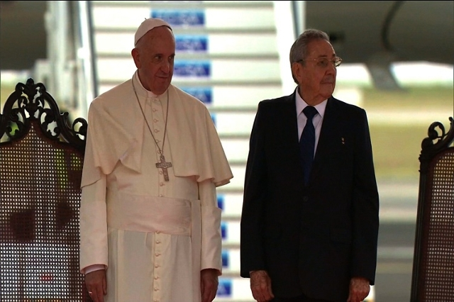 Pope Francis is greeted by Cuban President Raul Castro after arriving at Jose Marti International Airport in Havana. Francis is the third pontiff to visit Cuba. (Pool/CNN)