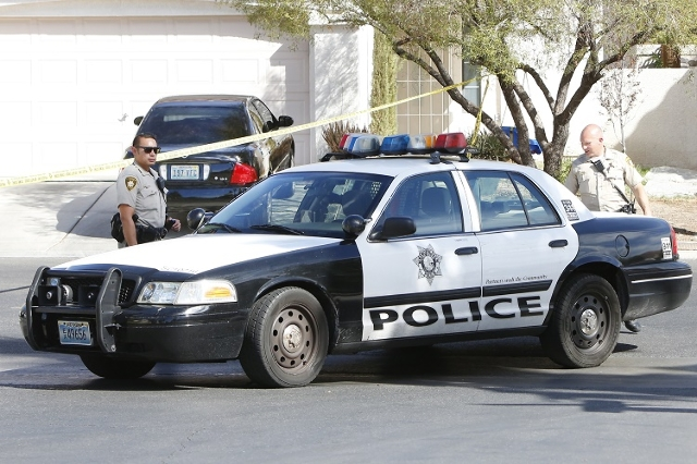 Metro police are investigating a barricade situation in the 600 block of Ribbon Grass Avenue Monday, Sept. 21, 2015. The man who locked himself in a house has died from a self-inflicted gunshot wo ...
