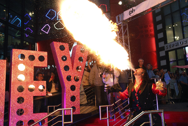 A fire breather performs before the arrival of Britney Spears at Planet Hollywood in Las Vegas Tuesday, Dec. 3, 2013. (John Locher/Las Vegas Review-Journal)