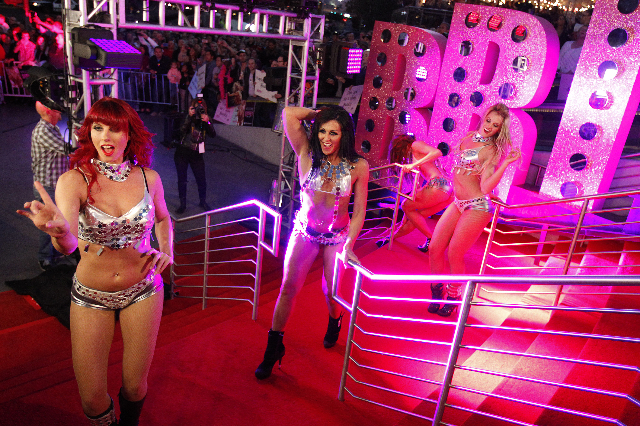 Dancers perform before the arrival of Britney Spears at Planet Hollywood in Las Vegas Tuesday, Dec. 3, 2013. (John Locher/Las Vegas Review-Journal)
