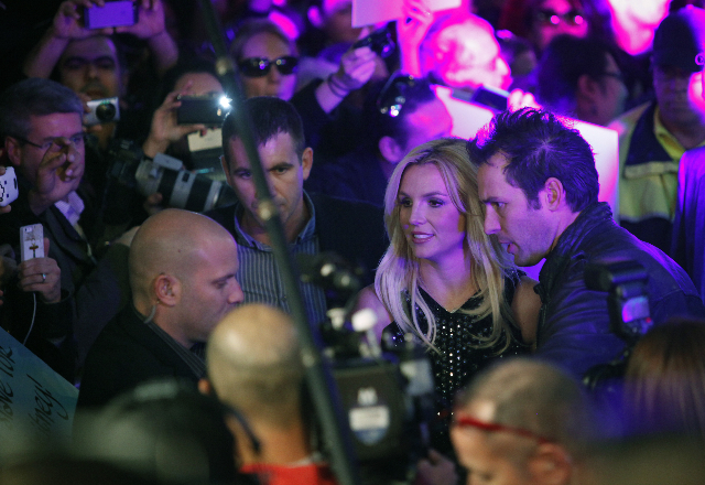 Britney Spears meets with fans in front of Planet Hollywood in Las Vegas Tuesday, Dec. 3, 2013 to promote her new show at the casino. (John Locher/Las Vegas Review-Journal)