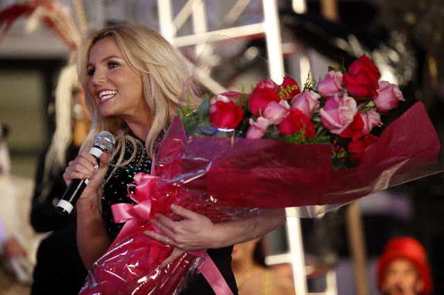 Britney Spears speaks to a crowd in front of Planet Hollywood in Las Vegas Tuesday, Dec. 3, 2013 to promote her new show at the casino. (John Locher/Las Vegas Review-Journal)