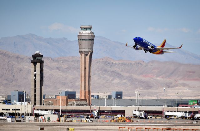 A Southwest Airline passenger jet takes off from McCarran International Airport under the control of the smaller of the two federal air traffic control towers on Monday, June 8, 2015. (David Becke ...