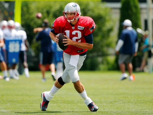 Aug 6, 2015; Foxborough, MA, USA; New England Patriots quarterback Tom Brady (12) scrambles during training camp at Gillette Stadium. (Winslow Townson/USA Today Sports)