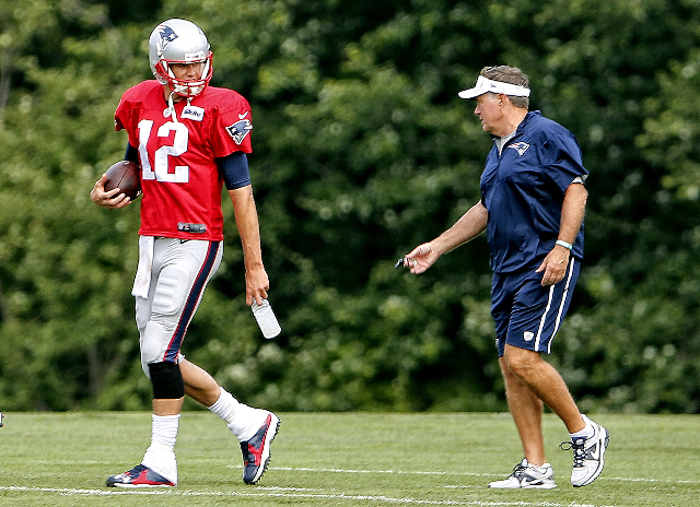 Aug 6, 2015; Foxborough, MA, USA; New England Patriots quarterback Tom Brady (12) talks with New England Patriots head coach Bill Belichick during training camp at Gillette Stadium. (Winslow Towns ...