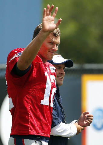 Aug 6, 2015; Foxborough, MA, USA; New England Patriots quarterback Tom Brady (12) waves to fans during training camp at Gillette Stadium. (Winslow Townson/USA Today Sports)