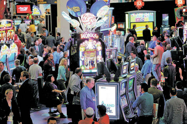 Slot machines line the show floor at the G2E convention in Las Vegas Tuesday, Sep. 24, 2013. (Jessica Ebelhar/Las Vegas Review-Journal)