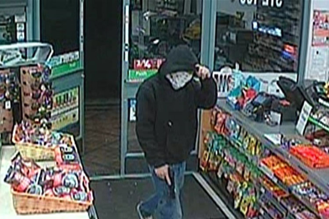 Henderson police are asking for help identifying the robber who hit a 7-Eleven in the 100 block of North Gibson Road on Sept. 20 and Sept. 25. (Henderson Police Dept.)